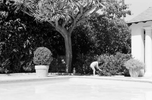Eloise playing by pool
