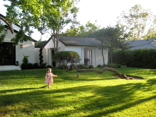 This is Eloise at age 2 running through the front yard on 4th Street
